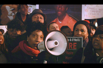 Colorlines Screenshot of (center, with megaphone) Constance Malcolm and supporters at a rally demanding justice for Malcolm's son Ramarley Graham, who NYPD officer Richard Haste killed in 2012. Screenshot taken from Twitter on February 3, 2017.