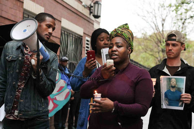 Advocates demand accountability during an April 22 rally outside the home of a gay man who was fatally shot by NYPD cops earlier in the month. [photo credit: Brian Brigantti]