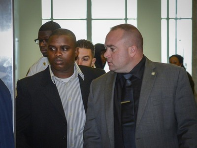 Wayne Isaacs (l.) is the first NYPD officer to be prosecuted by state Attorney General Eric Schneiderman under Gov. Cuomo's 2015 executive order. (ANTHONY DELMUNDO/NEW YORK DAILY NEWS)